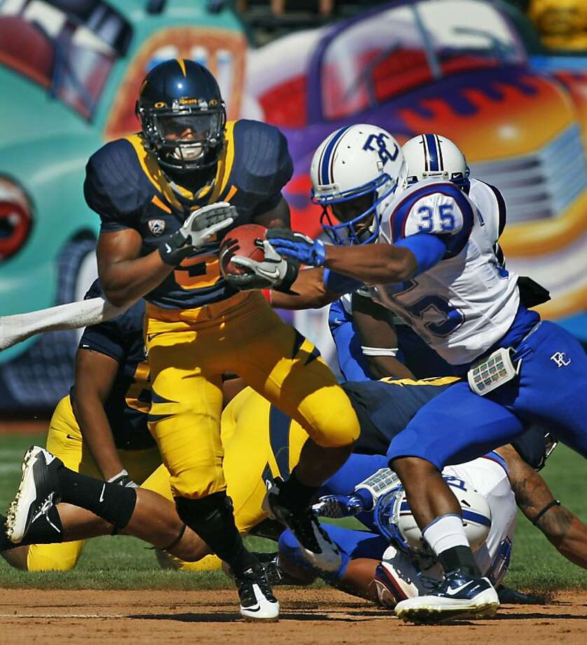 University of California tail back Brandan Bigelow drives through the Presbyterian defense in first half action Saturday September 17, 2011 at AT&T Park in San Francisco California. Cal won 63-12. Photo: Lance Iversen, The Chronicle