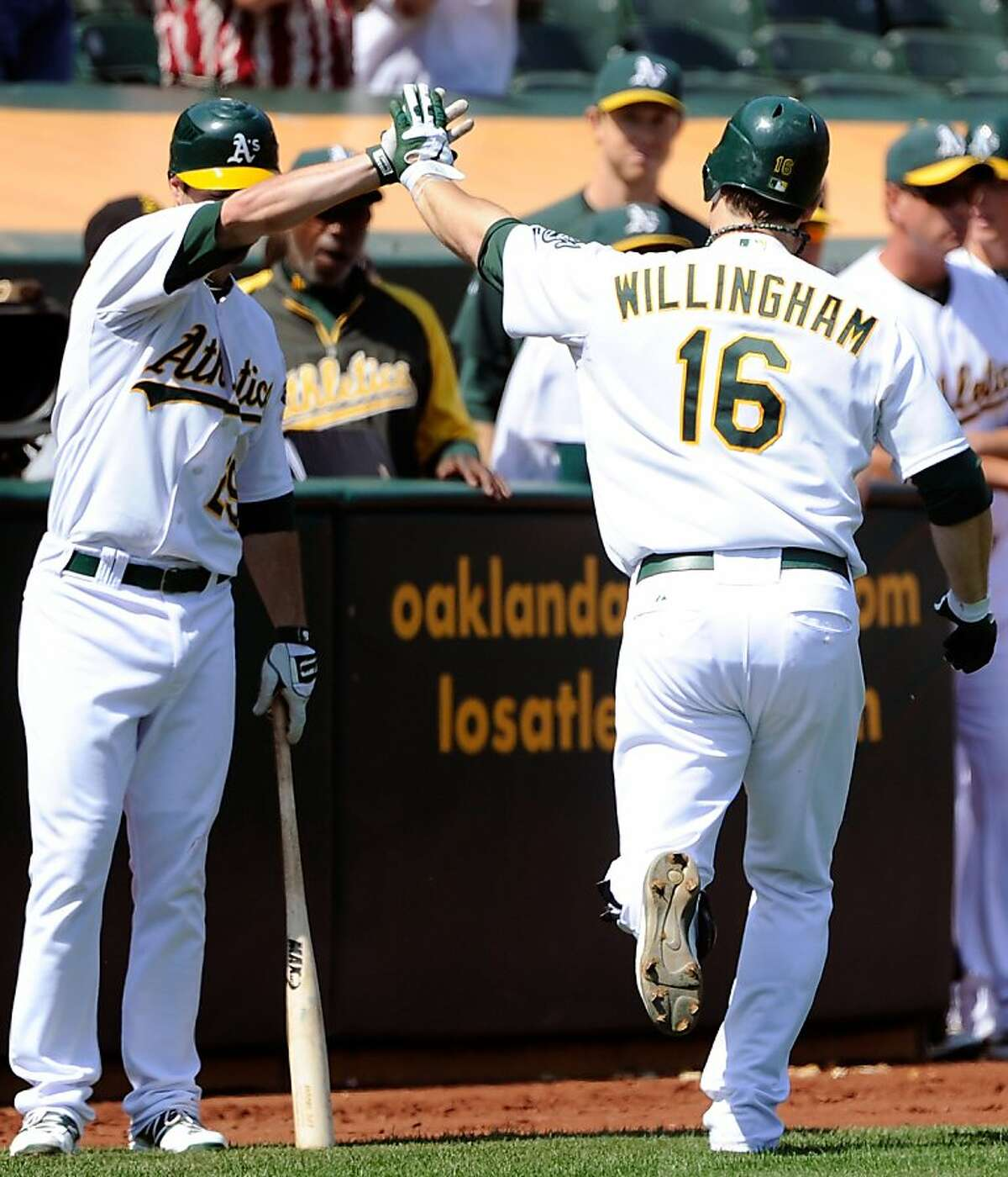 OAKLAND, CA - SEPTEMBER 14: Josh Willingham #16 of the Oakland Athletics celebrates with Scott Sizemore #29 after hitting a home run against the Los Angeles Angels of Anaheim in third Inning during an MLB baseball game at O.co Coliseum on September 14, 2011 in Oakland, California. (Photo by Thearon W. Henderson/Getty Images)