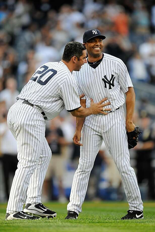 NEW YORK, NY - SEPTEMBER 19:  Jorge Posada #20 of the New York Yankees pushes his teammate Mariano Rivera #42 back towards the mound after Rivera broke the career saves record in a game against the Minnesota Twins at Yankee Stadium on September 19, 2011 in the Bronx borough of New York City. Rivera recorded his 602 save.  (Photo by Patrick McDermott/Getty Images) Photo: Patrick McDermott, Getty Images