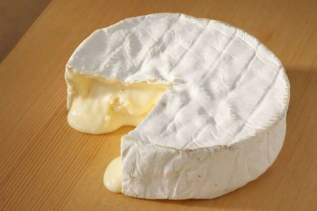 Coulommiers, a bloomy-rind cow's milk cheese from France as seen in San Francisco, California, on Wednesday, August 31, 2011.  Food styled by Clare Molla. Photo: Craig Lee, Special To The Chronicle