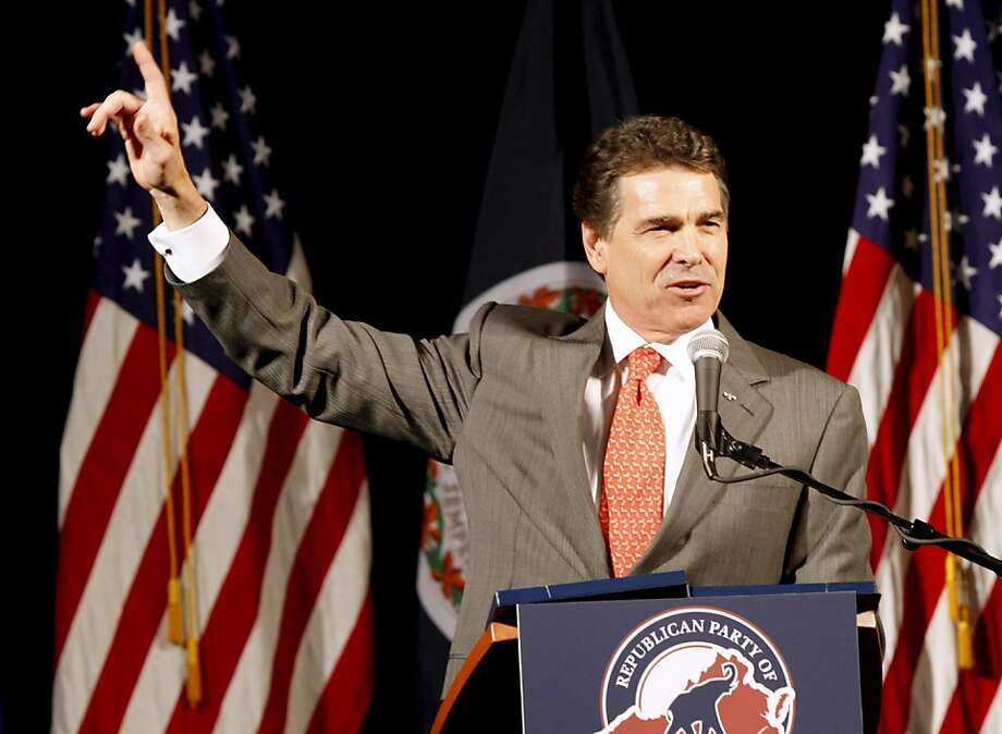 Republican Presidential candidate, Texas Gov. Rick Perry, gestures during a speech before a Virginia Republican fundraising event in Richmond, Va., Wednesday, Sept. 14, 2011. (AP Photo/Steve Helber) Photo: Steve Helber, AP