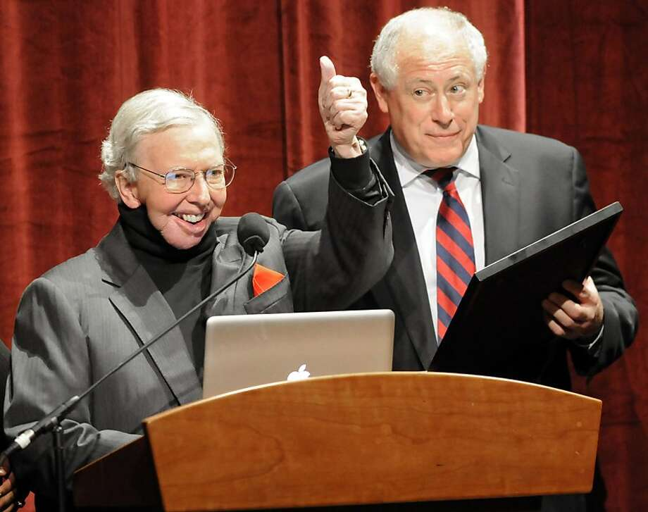 Film Critic Roger Ebert, left, gives a thumbs up to the audience as Illinois Governor Pat Quinn reads a proclamation declaring April 21, 2010 Roger Ebert Day in Illinois during the opening of the Twelfth Annual Roger Ebert's Film Festival at the Virginia Theatre in Champaign on Wednesday, April 21, 2010.(AP Photo/Robin Scholz/The News-Gazette)  Ran on: 04-30-2010 Roger Ebert, above right with the late Gene Siskel and below, will be honored by the San Francisco International Film Festival. Ran on: 04-30-2010 Roger Ebert, above right with the late Gene Siskel and below, will be honored by the San Francisco International Film Festival.  Ran on: 09-14-2010 Film critic Roger Ebert gives a thumbs-up as Illinois Gov. Pat Quinn (right) declares April 21 as Roger Ebert Day in Illinois. Ran on: 09-14-2010 Film critic Roger Ebert gives a thumbs-up as Illinois Gov. Pat Quinn (right) declares April 21 as Roger Ebert Day in Illinois. Photo: Robin Scholz, AP