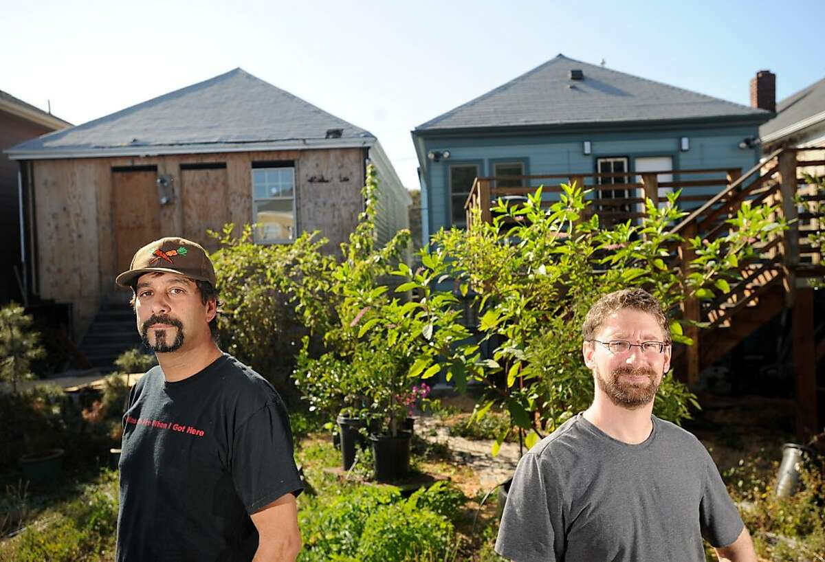 Joe Russack, right, and Omar El-Baroudi stand outside their houses on Friday, Sept. 16, 2011, in Oakland, Calif.