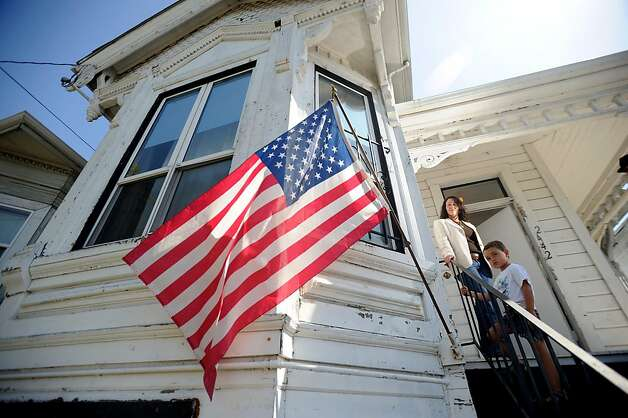 Michelle Cassens stands outside her Oakland, Calif., house with son Cassens Martin, 4, on Friday, Sept. 16, 2011. After inspectors condemned the home, Cassens began a fight against the city's Building Services department. Photo: Noah Berger, Special To The Chronicle