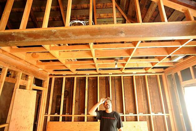 Omar El-Baroudi examines new framing in his Oakland, Calif., house on Friday, Sept. 16, 2011. Photo: Noah Berger, Special To The Chronicle