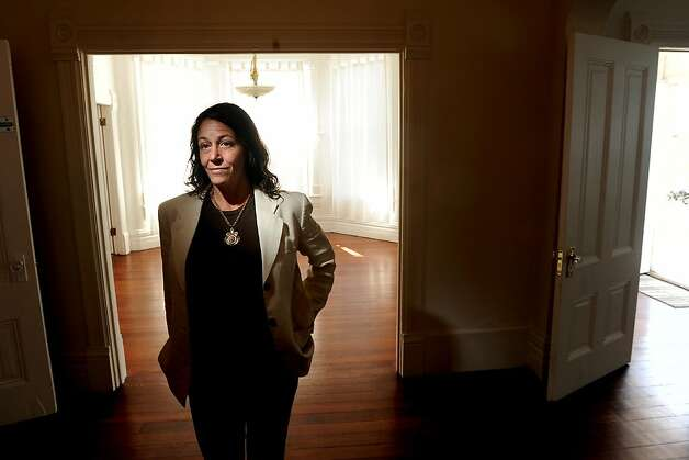 Michelle Cassens stands in her Oakland, Calif., house on Friday, Sept. 16, 2011. After inspectors condemned the home, Cassens began a fight against the city's Building Services department. Photo: Noah Berger, Special To The Chronicle