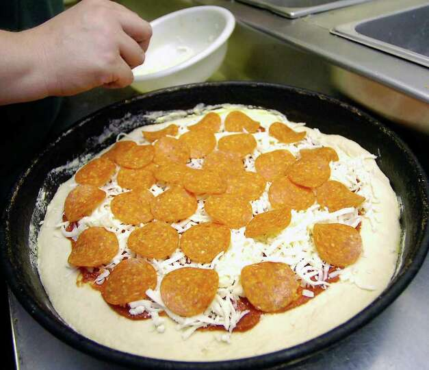 A ham and pepperoni pizza gets made in the kitchen.  Goodfella's Pizza in Sour Lake is our restauran