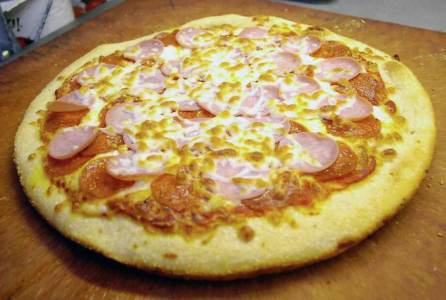 A finished pepperoni and ham pizza is ready to go.  Goodfella's Pizza in Sour Lake is our restaurant of the week for Oct. 6, 2011.   It is located at 785 Highway 105 West.  Dave Ryan/The Enterprise Photo: Dave Ryan
