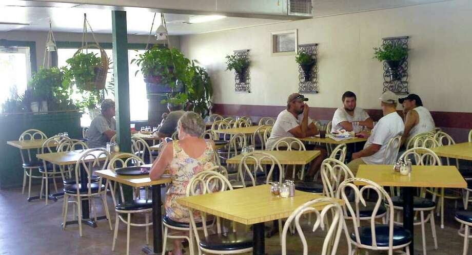The dining room at lunchtime on Monday.  Goodfella's Pizza in Sour Lake is our restaurant of the week for Oct. 6, 2011.   It is located at 785 Highway 105 West.  Dave  Ryan/The Enterprise Photo: Dave Ryan