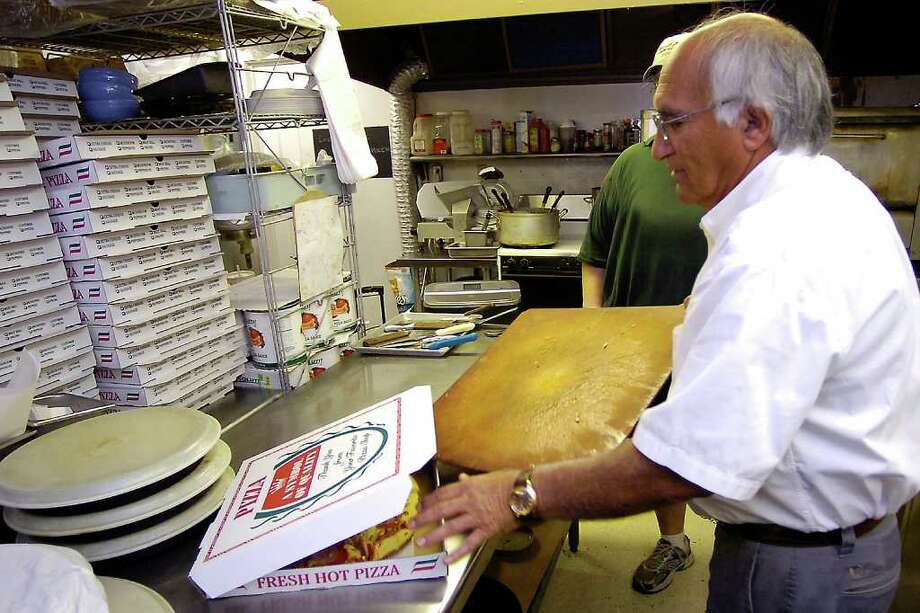 Hamid Sohrabi is the owner and here he readies another pizza.    Goodfella's Pizza in Sour Lake is our restaurant of the week for Oct. 6, 2011.   It is located at 785 Highway 105 West.  Dave Ryan/The Enterprise Photo: Dave Ryan