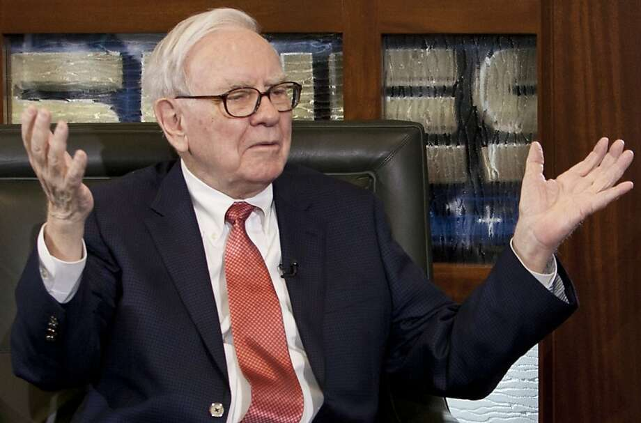 In this May 2, 2011 photo, billionaire investor Warren Buffett, Chairman and CEO of Berkshire Hathaway, gestures in Omaha, Neb. Berkshire Hathaway Inc. releases quarterly financial results Friday, May, 6, after the markets close.(AP Photo/Nati Harnik)  Ran on: 05-07-2011 CEO Warren Buffett's Berkshire Hathaway releases first-quarter results.   Ran on: 08-16-2011 Warren Buffett says the rich &quo;have been coddled long enough by a billionaire-friendly Congress.&quo; Photo: Nati Harnik, Associated Press