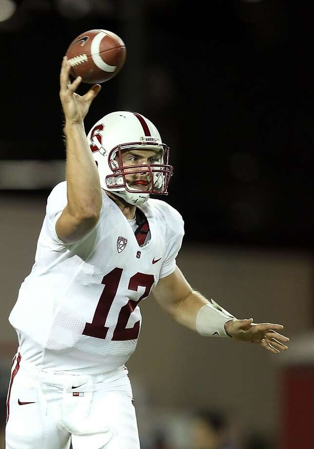 TUCSON, AZ - SEPTEMBER 17:  Quarterback Andrew Luck #12 of the Stanford Cardinal throws a pass during the college football game against the Arizona Wildcats at Arizona Stadium on September 17, 2011 in Tucson, Arizona.  (Photo by Christian Petersen/Getty Images) Photo: Christian Petersen, Getty Images