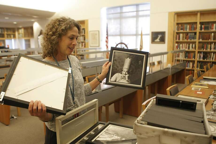 Susan Goldstein, city archivist, holds portraits by photographer Daniel Ellsberg that once hung on the walls of the Washington Square Bar and Grill, at the San Francisco Public Library on Friday, Sept. 16, 2011.  The restaurant closed earlier this year. Photo: Dylan Entelis, The Chronicle