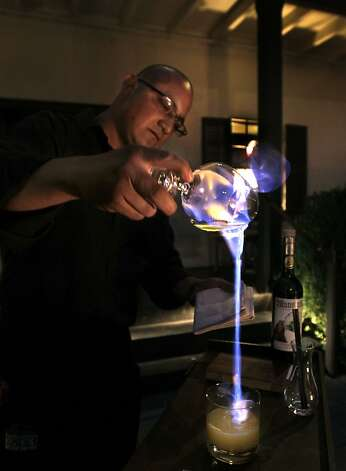 Adalberto Mata prepares a fiery absinthe cocktail at Restaurant 1833 in Monterey, Calif. on Tuesday, August 9, 2011. Photo: Paul Chinn, The Chronicle