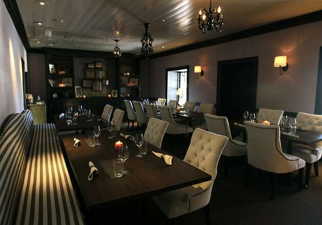 Dinner tables are set in Hattie's Room at Restaurant 1833 in Monterey, Calif. on Tuesday, August 9, 2011. Many believers are convinced that the dining room, named for Harriet (Hattie) Gragg, who lived in the home from 1890 until her death in 1948, is still occupied by her ghost. Photo: Paul Chinn, The Chronicle