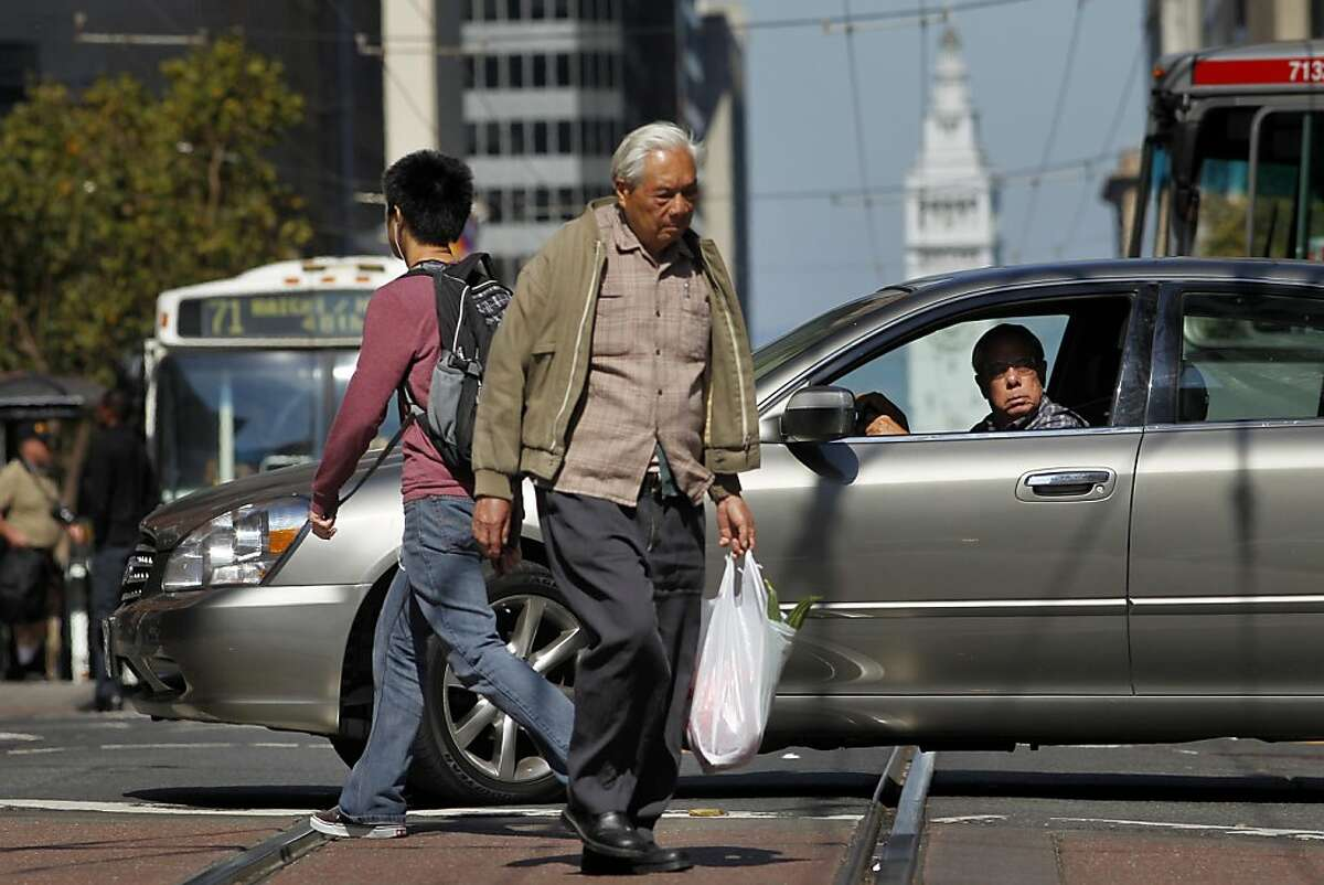 People and traffic clog up Market Street, Tuesday September 13, 2011 in San Francisco, Calif. Board of Supervisors David Chiu is expected to propose a new proposal to restricted private automobiles along Market Street.