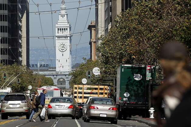 People and traffic clog up Market Street. Photo: Lacy Atkins, The Chronicle