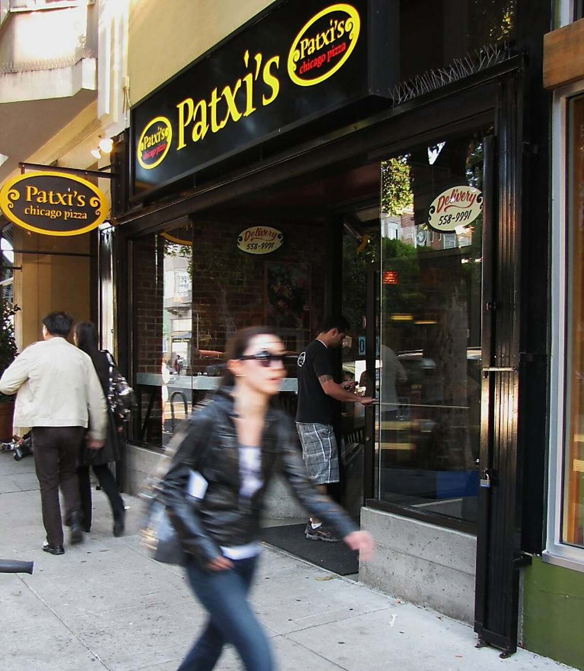 Patxi's Chicago Pizza is paying back 115 current and past employees - who were denied medical coverage from 2009 to 2011 - a total of $205,000. Patxi's will also pay $15,000 in penalties to the city.