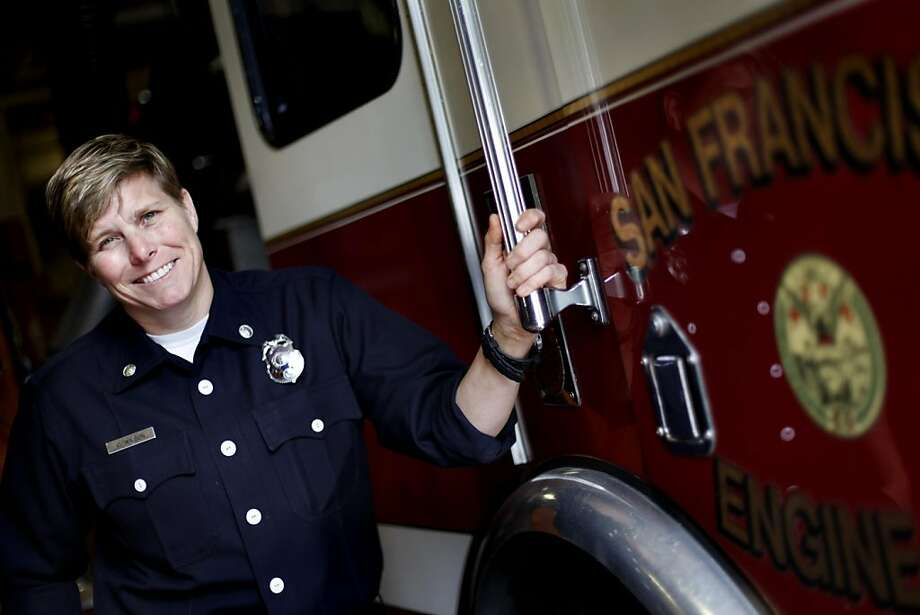 Chase Wilson received an award for rushing into a burning home with a fellow firefighter to save an unconscious woman.  Wilson, an acting captain at San Francisco Fire Department station 32, is photographed at the firehouse in San Francisco, Calif., Friday, September 16, 2011. Photo: Sarah Rice, Special To The Chronicle