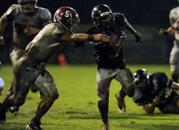 Ansonia High School's Arkeel Newsome tries to avoid a tackle from Bethel High School's Brandon Schmidt Tuesday, Nov. 29, 2011 during the Class M Football quarterfinal at Nolan Field in Ansonia, Conn. Photo: Autumn Driscoll / Connecticut Post