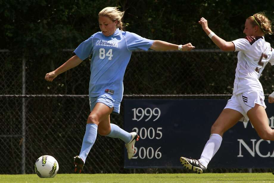 Courtney Jones, daughter of former 49ers football player Brent Jones, is a star player on the UNC Chapel Hill Women's soccer team.  After streaking down the right sideline Jones crosses the ball into the 6 yard box to a teammate in a game against Texas A&M in Durham North Carolina, on September 11, 2011.  Jones' assisted two out of the three goals scored by the Tar Heels, however it was not enough. Texas A&M would battle back to tie the game in regulation and then beat the higher ranked UNC Tar Heels 4-3 in the first minute of overtime. Jones did not play in overtime due to a head injury that she received towards the end of the second half. Photo: Audrey Whitmeyer-Weathers