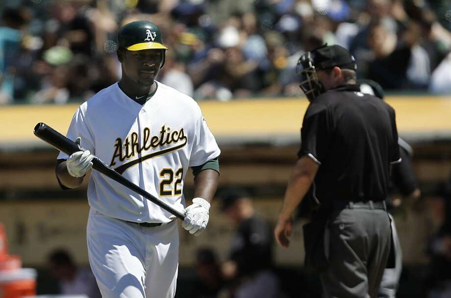 The Athletics Chris Carter walks back to the dug out after striking out in the eighth inning during the the Oakland Athletcis vs. Florida Marlins game in Oakland, Calif. Final score: Marlins: 5 - Oakland: 4. Photo: Lea Suzuki, The Chronicle