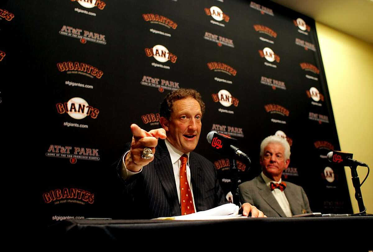 Giants President and Chief Operating Officer Larry Baer, left answers question about the announcement that Giants Managing General Partner and CEO Bill Neukom will be retiring at the end on the year leaving Baer as with his duties and succeeding him as CEO, Thursday September 15, 2011, in San Francisco, Calif.
