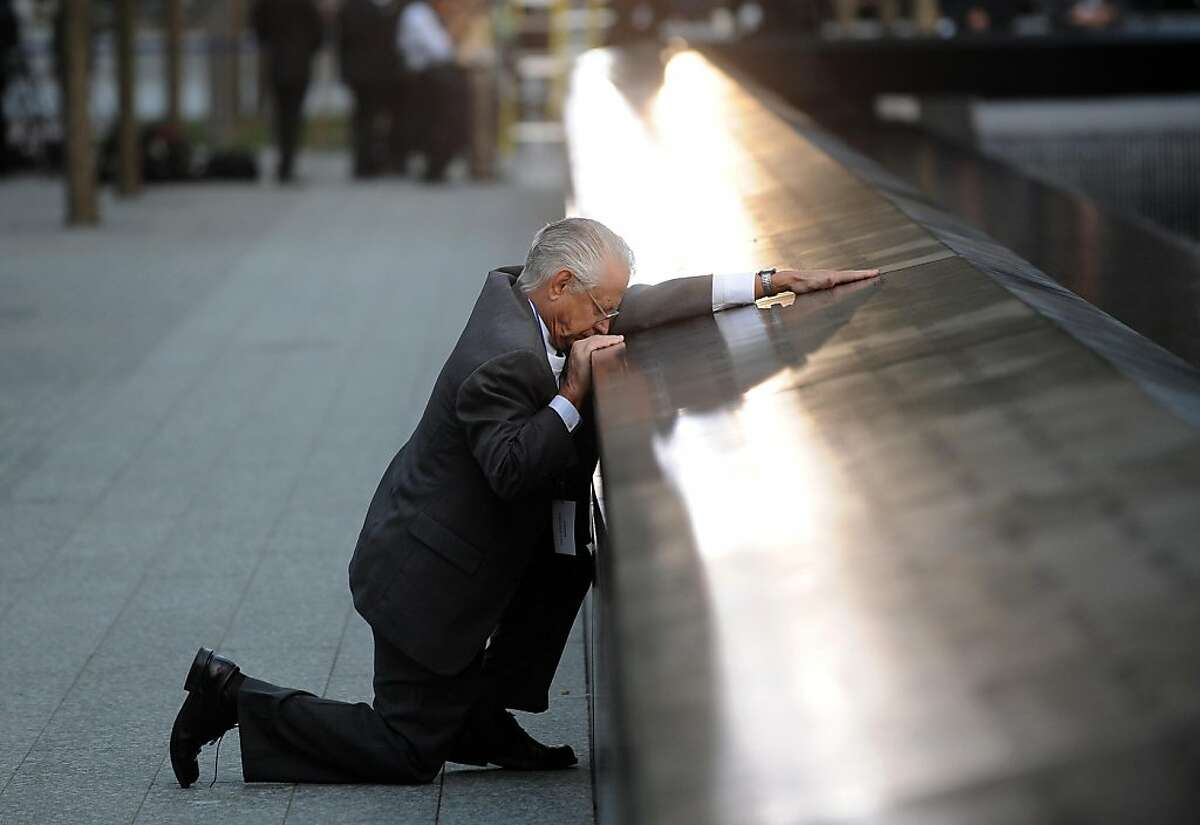 NEW YORK, NY - SEPTEMBER 11: Robert Peraza, who lost his son Robert David Peraza, pauses at his son's name at the North Pool of the 9/11 Memorial during tenth anniversary ceremonies at the site of the World Trade Center on September 11, 2011, in New York City. New York City and the nation are commemorating the tenth anniversary of the terrorist attacks which resulted in the deaths of nearly 3,000 people after two hijacked planes crashed into the World Trade Center, one into the Pentagon in Arlington, Virginia and one crash landed in Shanksville, Pennsylvania. (Photo by Justin Lane-Pool/Getty Images) *** BESTPIX ***