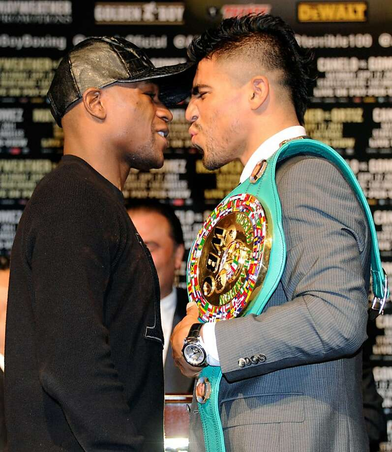 LAS VEGAS, NV - SEPTEMBER 14:  Boxers Floyd Mayweather Jr. (L) Victor Ortiz face off during the final news conference for their bout at the MGM Grand Hotel/Casino September 14, 2011 in Las Vegas, Nevada. Mayweather will challenge Ortiz for the WBC welterweight title on September 17, 2011 in Las Vegas.  (Photo by Ethan Miller/Getty Images) Photo: Ethan Miller, Getty Images