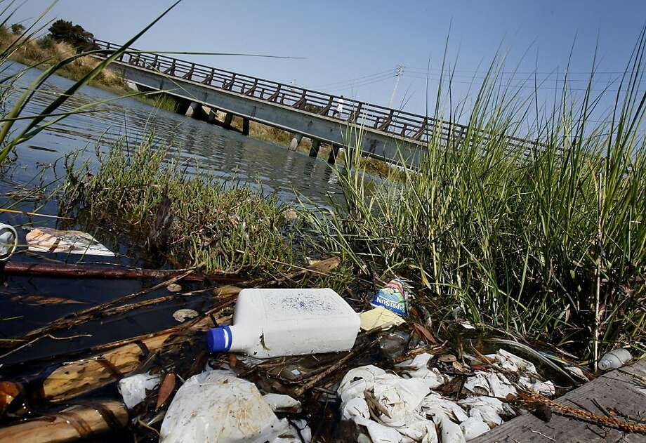 Litter can be seen on the south side of Damon Creek near the pedestrian bridge. Save the Bay issues its list of top trashiest spots in and around the San Francisco Bay which include Damon Slough in Oakland, Calif. and Mission Creek in San Francisco, Calif. Photo: Brant Ward, The Chronicle