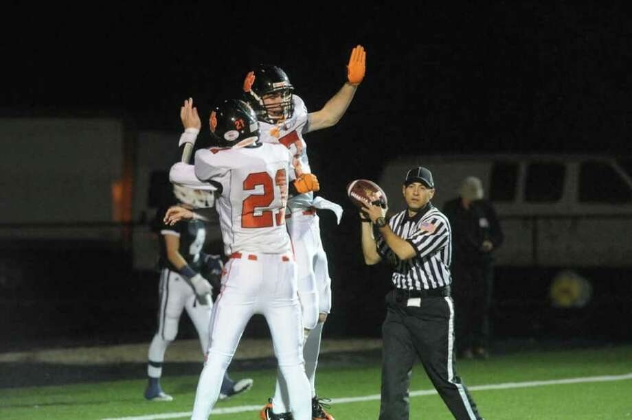 Ridgefield's Neil Gollogly and John Heller celebrate a touchdown as Ridgefield and Staples High Schools face off in a Class LL football quarterfinals game at Wilton High School in Wilton, Conn., November 2, 2011. Photo: Keelin Daly / Keelin Daly