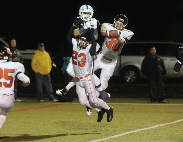 Ridgefield and Staples High Schools face off in a Class LL football quarterfinals game at Wilton High School in Wilton, Conn., November 2, 2011. Photo: Keelin Daly / Keelin Daly