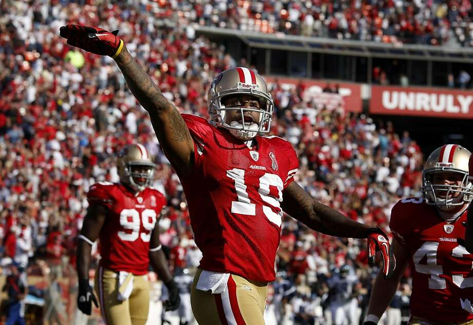 The 49ers Ted Ginn Jr. waved to the crowd after his first runback touchdown. The San Francisco 49ers defeat the Seattle Seahawks 33-17 at Candlestick Park Sunday September 11, 2011.  Ran on: 09-12-2011 Ted Ginn Jr. celebrates his 102-yard fourth-quarter kickoff return for a TD. Less than a minute later, he scored on a punt return. Ran on: 09-12-2011 Ted Ginn Jr. celebrates his 102-yard fourth-quarter kickoff return for a TD. Less than a minute later, he scored on a punt return. Ran on: 09-12-2011 Ted Ginn Jr. celebrates his 102-yard fourth-quarter kickoff return for a TD. Less than a minute later, he scored on a punt return. Photo: Brant Ward, The Chronicle
