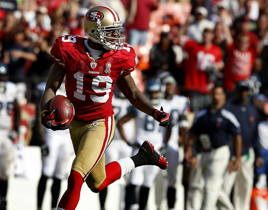 Ted Ginn Jr. looks back at the defense after scoring his first runback touchdown. The San Francisco 49ers defeat the Seattle Seahawks 33-17 at Candlestick Park Sunday September 11, 2011. Photo: Brant Ward, The Chronicle