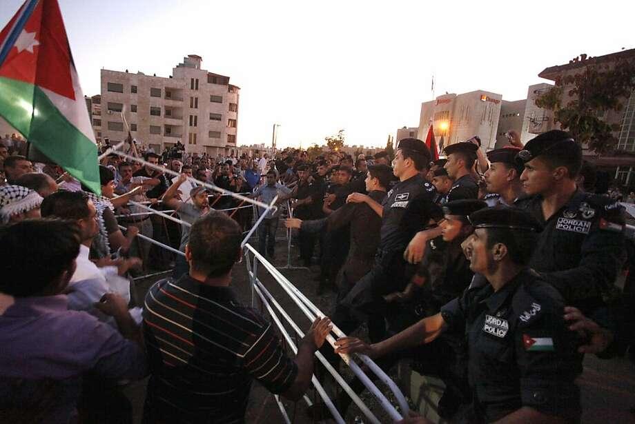 About 300 rally outside Israeli Embassy in Jordan - SFGate