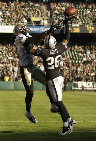Oakland Raiders cornerback Stanford Routt (26) breaks up a pass inteneded for New Orleans Saints wide receiver Marques Colston (12) in the second quarter of a preseason NFL football game in Oakland, Calif., Sunday, Aug. 28, 2011. (AP Photo/Marcio Jose Sanchez) Photo: Marcio Jose Sanchez, AP