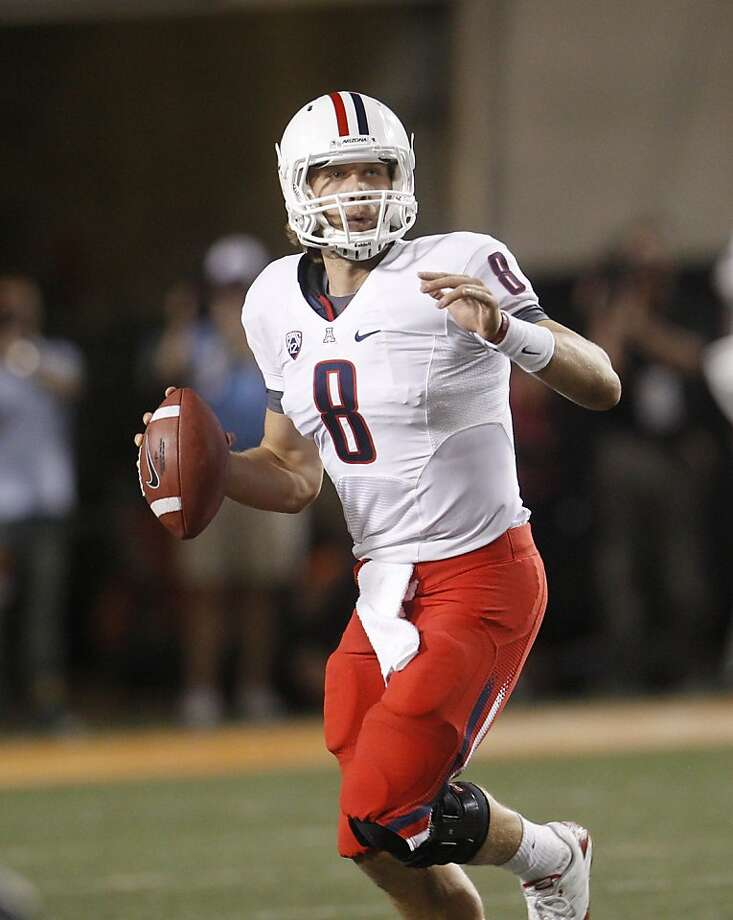 Arizona quarterback Nick Foles passes in an NCAA college football game against Oklahoma State in Stillwater, Okla., Thursday, Sept. 8, 2011. (AP Photo/Sue Ogrocki) Photo: Sue Ogrocki, AP