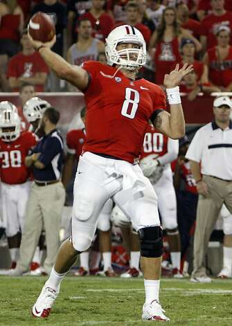 Arizona starting quarterback Nick Foles (8) throws against Northern Arizona in the third quarter of an NCAA college football game at Arizona Stadium in Tucson, Ariz., Saturday, Sept. 3, 2011. Foles threw for 412 yards. Arizona won 41 - 10. (AP Photo/Wily Low) Photo: Wily Low, AP