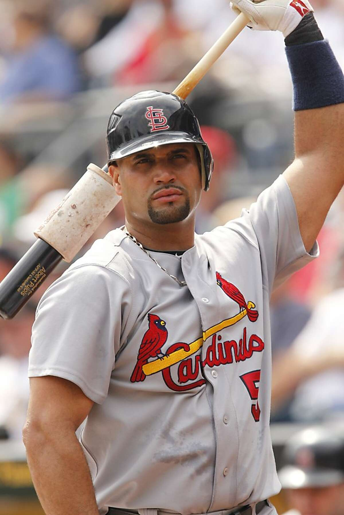 St. Louis Cardinals' Albert Pujols warms up on deck during the third inning of a baseball game against the Pittsburgh Pirates in Pittsburgh Wednesday, Sept. 14, 2011. (AP Photo/Gene J. Puskar)