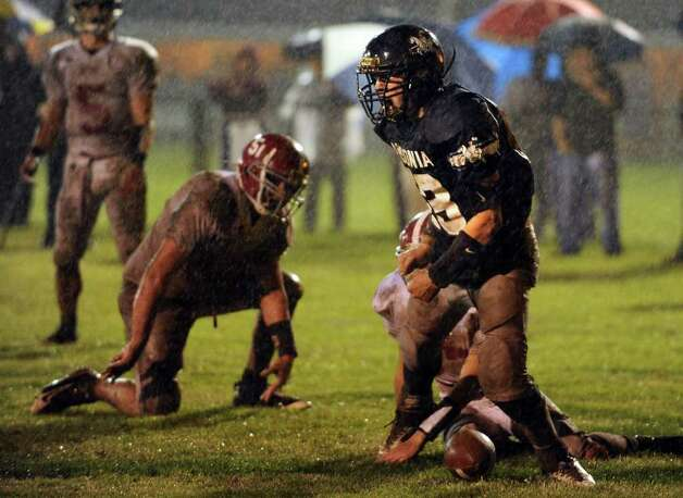 Ansonia High School's Tyler Lester celebrates a touchdown as Bethel players look on Tuesday, Nov. 29, 2011 during the Class M Football quarterfinal at Nolan Field in Ansonia, Conn. Photo: Autumn Driscoll / Connecticut Post