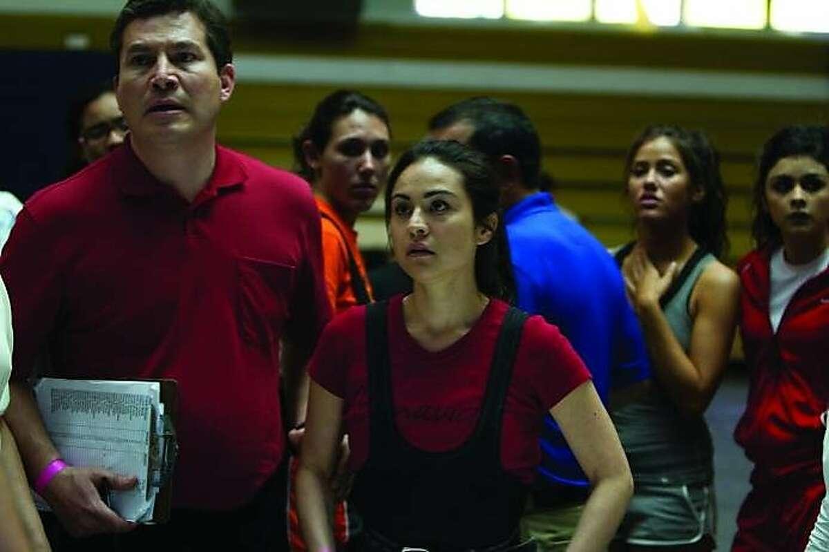 "Julio Cesar Cedillo, left, and Corian Calderon appear in a scene from, ""All She Can.'"