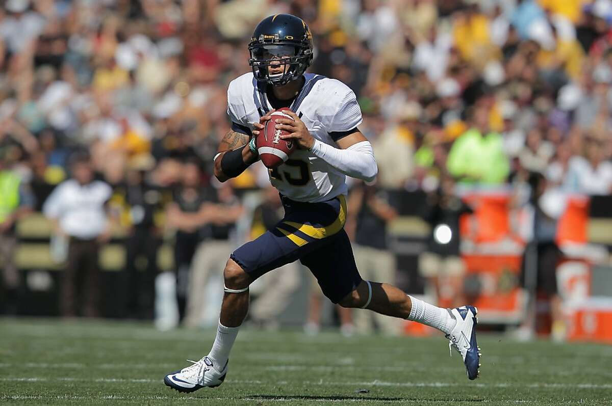 BOULDER, CO - SEPTEMBER 10: Quarterback Zach Maynard #15 of the California Golden Bears rolls out to pass against the Colorado Buffaloes at Folsom Field on September 10, 2011 in Boulder, Colorado. (Photo by Doug Pensinger/Getty Images)