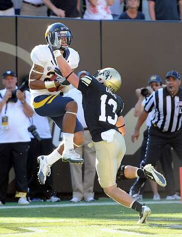 California's Keenan Allen catches the winning touchdown over Colorado's Parker Orms at an NCAA college football game in Boulder, Colo., Saturday, Sept. 10, 2011. (AP Photo/The Daily Camera, Cliff Grassmick)  EXAMINER OUT; NO SALES  Ran on: 09-11-2011 Cal's Keenan Allen catches the winning touchdown in overtime. Photo: Cliff Grassmick, AP