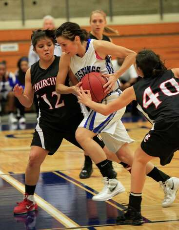 Jay's Ashley Mandujano cuts through the Churchill defense of Avery Rodriguez (left) and Rebecca Flores. Photo: J. Michael Short, Special To The Express-News / The San Antonio Express-News