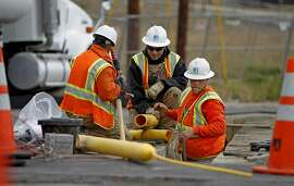 PG&E workers continue to place distribution gas lines at  along Claremont to close to the intersection of Glenview, Wednesday September 14, 2011, in San Bruno, Calif.
