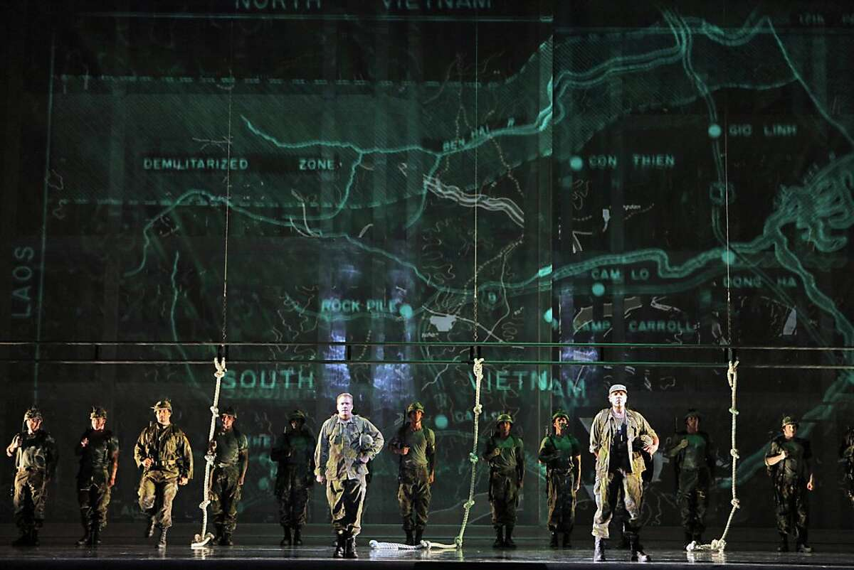 """William Burden (Dan Hill), Thomas Hampson (Rick Rescorla) and soldiers train at Ft. Benning appear in a scene from SF Opera's, """"Heart of a Soldier."""""""
