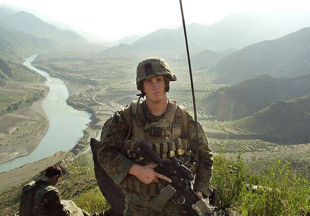 In this undated photo released by the U.S. Marines, Sgt. Dakota Meyer poses for a photo while deployed in support of Operation Enduring Freedom in Ganjgal Village, Kunar province, Afghanistan. The White House announced the 23-year-old Marine scout sniper from Columbia, Ky., who has since left the Marine Corps, will become the first living Marine to be awarded the Medal of Honor in decades for his actions in Afghanistan. (AP Photo/U.S. Marines) Ran on: 09-15-2011 Marine Dakota Meyer will receive the military's highest honor today, making him the first from his branch who is living to receive the honor for action in Iraq or Afghanistan. Photo: U.S. Marines, AP
