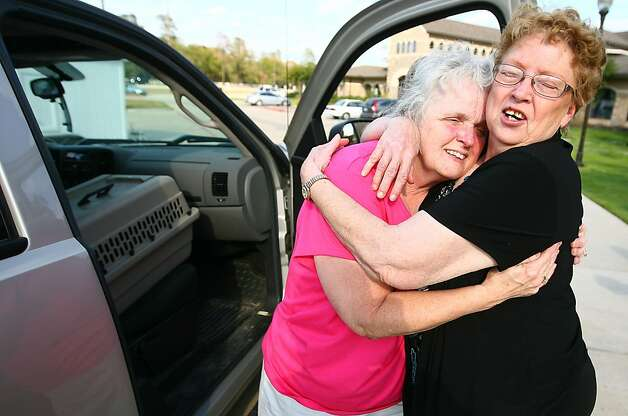 Alice Buchanan of Magnolia, Texas, left, and Judy Watinks of Plantersville, Texas, say goodbye in the parking lot of the Red Cross shelter at Wildwood United Methodist Church on Sunday, Sept. 11, 2011 in Magnolia. The women became friends at the shelter after approaching wildfires forced them to evacuate from their homes. (AP Photo/The Courier, Karl Anderson) Photo: Karl Anderson, AP