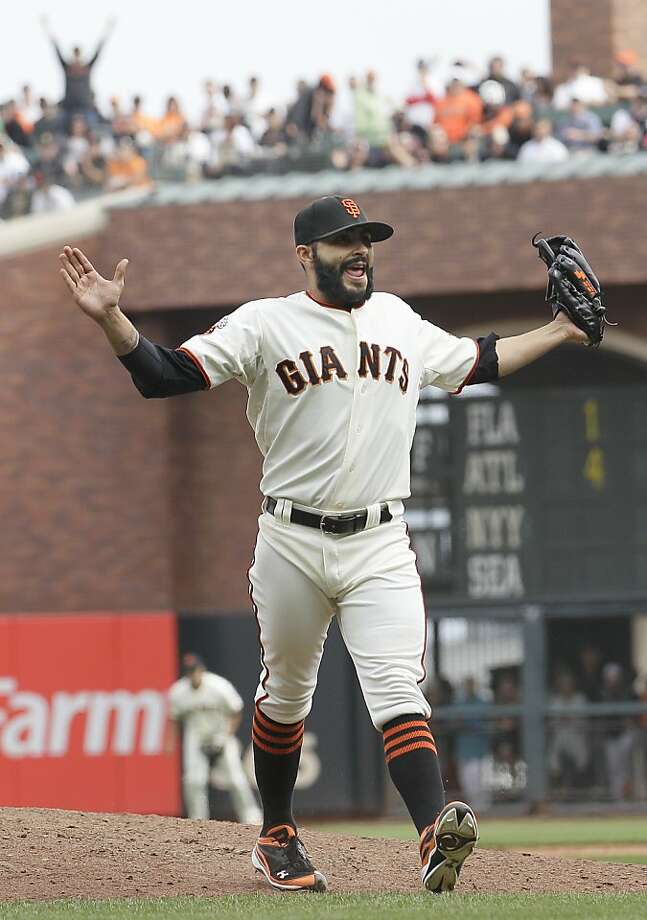 San Francisco Giants pitcher Sergio Romo celebrates after striking out San Diego Padres' Cameron Maybin to end the top of the eighth inning of a baseball game in San Francisco, Wednesday, Sept. 14, 2011. (AP Photo/Jeff Chiu) Photo: Jeff Chiu, AP