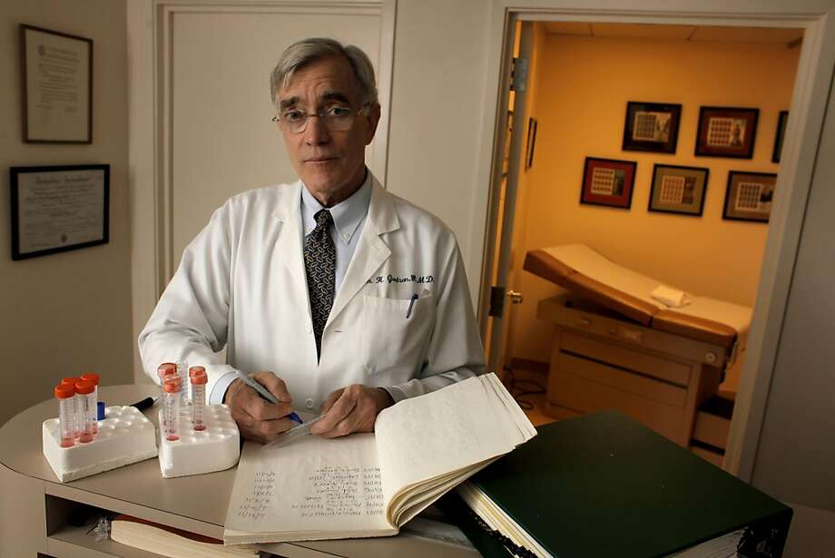 Dr. William Goodson III labels test tubes with a code, which is connected to the patient, and carries specimen, MOnday September 12, 2011, in San Francisco, Calif.  Goodson is the lead author of a study that shows two chemicals common in consumer products -- bisphenol-A and methyl paraben -- cause healthy cells to grow and survive like cancer cells and can interfere with the effectiveness of anti-cancer drugs. Photo: Lacy Atkins, The Chronicle